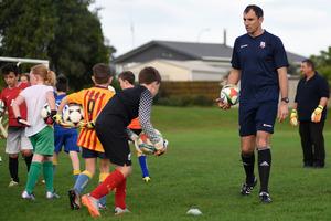 Coach James Bannatyne gives some goalkeeping tips. Photo/George Novak