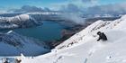 A skier at the top of the Ohau Ski Area, Mackenzie Basin, South Island. Lake Ohau is below. Photo / Sarah Ivey