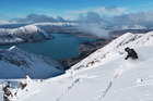 A skier at the top of the Ohau Ski Area, Mackenzie Basin, South Island. Lake Ohau is below. Photo / Sarah Ivey