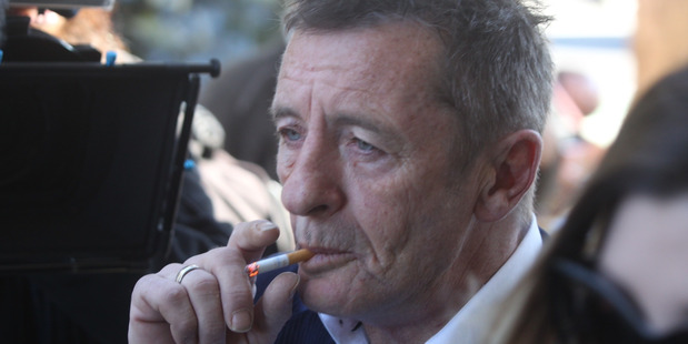 Phil Rudd arriving at Court in Tauranga in July 2015. Photo / Alan Gibson