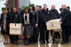 Boxes containing koiwi tangata (skeletal remains) of 33 Maori are carried onto Te Papa's Rongomaraeroa Marae during a repatriation powhiri, Wellington in 2009. Photo / Mark Mitchell