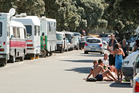 John Key announced a $12 million fund to help small communities cope with freedom campers in particular. Photo / NZME