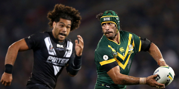 Kiwis prop Adam Blair chases Johnathan Thurston. Photo / Getty Images