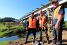 Regional councillor Monty Knight (left), Kevin Matthews (son of farm owner Malcolm Matthews) and NRC Kaitaia area manager Peter Wiessing checking progress on the new bridge. Photo / NRC