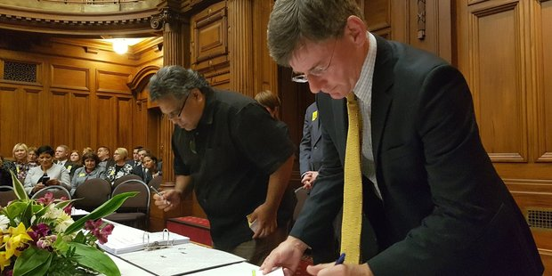Lead negotiator Jason Kerehi and Minister for Treaty of Waitangi Negotiations Christopher Finlayson, initialling the Deed of Settlement at Parliament yesterday. PHOTO/FILE