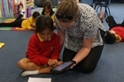 Kids using tech devices in the classroom at Stanhope school in Mt Wellington.