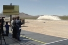 A company that hopes to zip people and cargo through tubes at hundreds of miles per hour showed off its propulsion system in North Las Vegas.