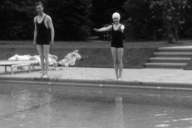The picture shows Princess Elizabeth swimming with her father King George V.