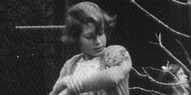 A young Princess Elizabeth with a bird on her arm.