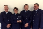 Constable Rowena Jones displaying the award won by the Kaitaia police, with Senior Sergeant Geoff Ryan (left), Constable Jeff Phillipps and District Commander Superintendent Russell le Prou.