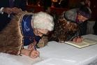 Ngati Kahungunu ki Wairarapa Tamaki Nui-a-Rua kaum?tua Miriama Theo Hape and Putiputi Tipene (nee Rautu) sign the Treaty of Waitangi agreement in principle at the Dannevirke Town Hall on Saturday.
