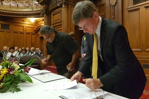 Lead negotiator for Rangit ne o Wairarapa and Rangit ne o Tamaki nui- -Rua, Jason Kerehi (left), and Minister for Treaty of Waitangi negotiations Christopher Finlayson initialling the Deed of Settlement at Parliament yesterday.