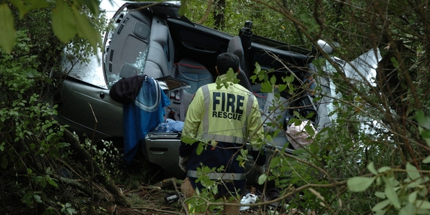 CRASH: Three occupants had to be cut free after yesterday's crash. PHOTO/LAURILEE MCMICHAEL
