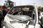Damaged vehicle is seen in Baghdads predominantly-Shia Sadr City district, in Iraq. Photo / Getty Images