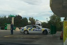 HUNT: Police at BP service station in Bay View during a pursuit related to a home invasion in Hastings. PHOTO PAUL TAYLOR