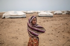 Ashwaq, 12, stands outside her family's tent, at the Markaze refugee camp in Obock, northern Djibouti. Photo / AP