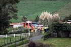 Emergency services gather at the rural Tauranga property where a plane crashed.