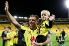 SIGNING OFF: Ben Sigmund and son, Cameron, farewell the Yellow Fever brigade in his  final match for the Phoenix on April 10. PHOTO/Getty Images