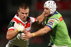 Euan Aitken of the Dragons is tackled by Jarrod Croker of the Raiders. Photo / Getty