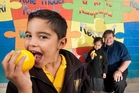 Rotorua Primary pupils are surrounded by outlets selling an array of foods, some of which are high-sugar, high fat. But principal John Naera says a school fruit programme is helping his pupils make healthier choices. Photo / Ben Fraser
