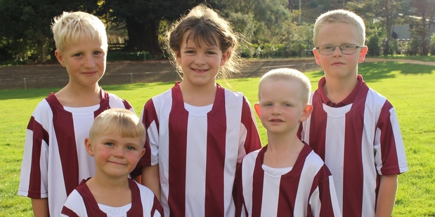 FOOTBALL FRIENDS: Almost 50 Hunterville children have registered to play football including, from left, Javaark Kennedy-Goodwin, Liam Watson, Sophie Cherrie, Duncan McIntyre and Evan McIntyre.