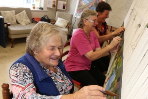 Nancy Jackson, Jackie Broughton and Colleen Hunter put the finishing touches on a tapestry that's taken thousands of hours. Photo / Michael Cunningham