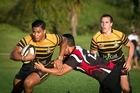 Greerton Marist's Monty Ioane tries to break a tackle in the 20-19 win over Arataki on Saturday. Photo / Andrew Warner