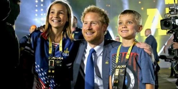 Prince Harry poses with athletes' children at the opening ceremony of the Invictus Games in Florida. Photo: Chris Jackson/Getty