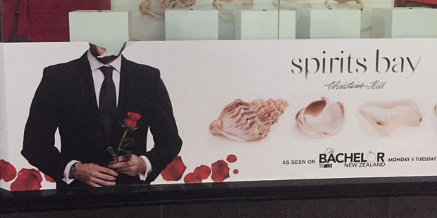 A defaced Bachelor poster at the Auckland Queen Street branch of Michael Hill.