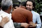 People comfort Musa Gilani, right, the brother of Ali Haider Gilani. Photo / AP