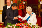 The Queen and President Xi Jinping at a state banquet at Buckingham Palace last year. Photo / Getty Images