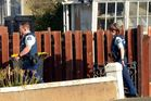 Police officers attend the scene of a Dunedin dog attack yesterday. Photo by Stephen Jaquiery / ODT