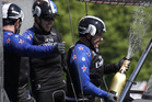Ray Davies of the Emirates Team New Zealand crew, right, sprays champagne after winning the America's Cup World Series sailing event in New York. Photo / AP