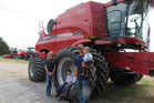 Jordan Hickel and his family stand next to their combine. Photo / Andrea Peterson, Washington
