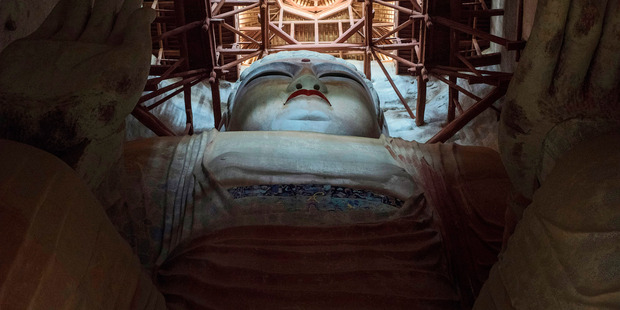 The Great Buddha in cave 96, dating from early Tang Dynasty. Photo / Gilles Sabrié for the Washington Post