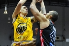 Tony Tolovae of the Taranaki Mountainairs gets blocked by Marques Whippy of the Rams. Photo / Photosport