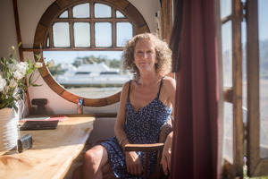Mary Christie on her houseboat Kukurei, which is moored at Waiheke Island. Pic Ted Baghurst