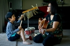 James Wong and May Clulee use different instruments to help James deal with challenging situations. Photo / Dean Purcell