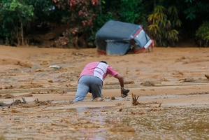 Hopes fade for villagers trapped by landslides