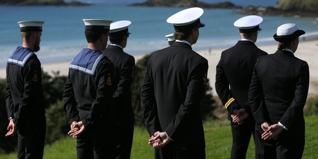 Naval officers, with Ocean Beach in the background.