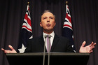 Dutton toned down his earlier language, which critics slammed as xenophobic. Photo / Getty Images