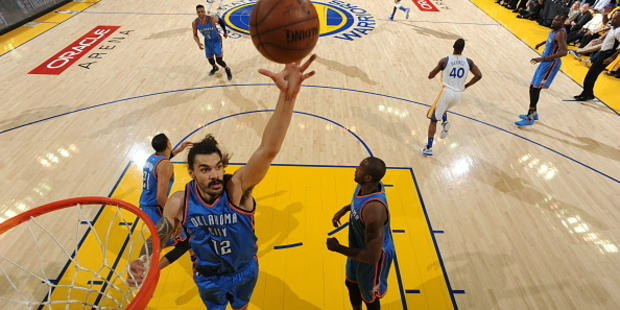 Steven Adams grabs the rebound against the Golden State Warriors. Photo / Getty Images