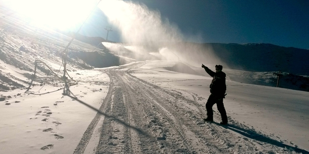 Snow and more snow - snowmaker Harry Blunden watches the machines working hard at Mt Hutt.