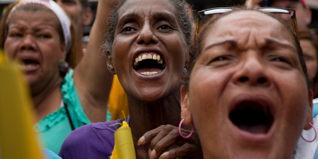 Women chant against the government of President Nicolas Maduro during a march in Caracas, Venezuela. Photo / AP
