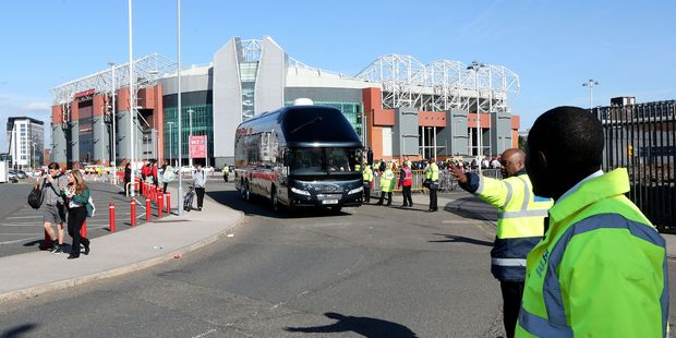 The AFC Bournemouth team coach leaves the ground at the English Premier League soccer match at Old Trafford, Manchester. Photo / AP