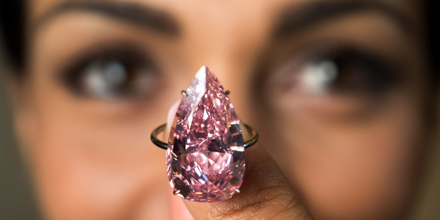 The Unique Pink, the largest fancy vivid pink pear-shaped diamond ever offered at an auction. Photo / AP
