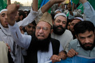 Supporters of Jamaat-e-Islami in Peshawar, Pakistan, condemn the execution of the Bangladesh's party chief Motiur Rahman Nizami. Photo / AP