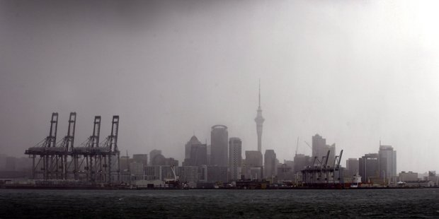 Storm front hitting Auckland city. Photo / Dean Purcell