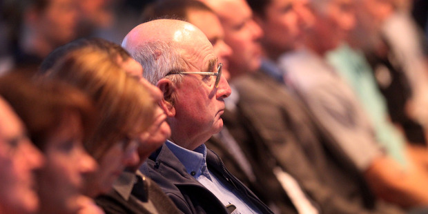 Farmers listen in silence to speakers at the Fonterra annual meeting held at Waitoa in the Waikato. Photo / File