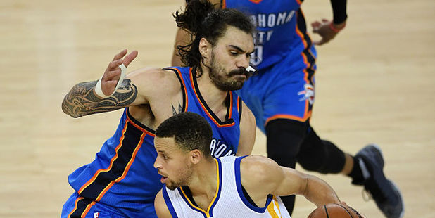 Oklahoma City Thunder centre Steven Adams defending Golden State Warriors guard Stephen Curry. Photo / Getty